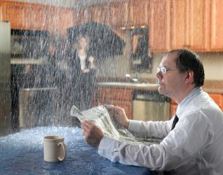 People in need of roof repair in Minneapolis MN. Leaky roof causing it to rain on people in their kitchen. Humorous.