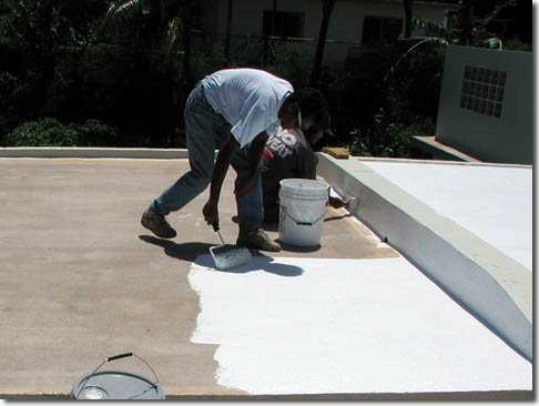 Roofer applying roof coating in Circle Pines, MN
